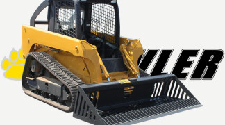 Skid Steer Equipped With Rock Bucket